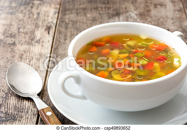 Vegetable soup in bowl on wooden table - csp49893652