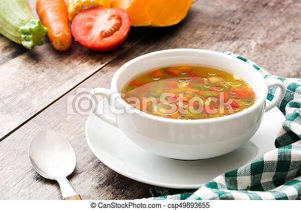 Vegetable soup in bowl on wooden table - csp49893655