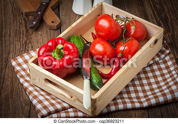 Vegetables in a wooden box. - csp36923211