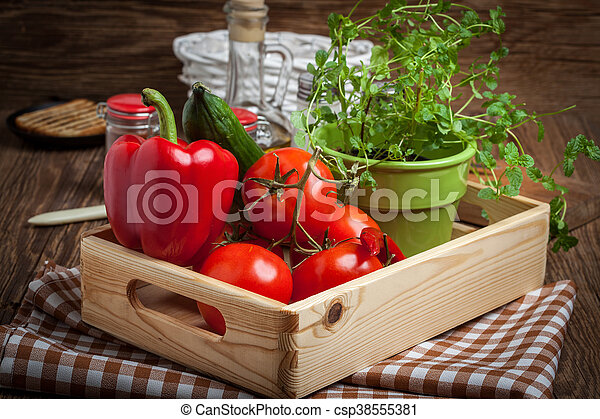 Vegetables in a wooden box. - csp38555381
