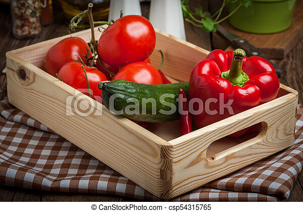 Vegetables in a wooden box. - csp54315765