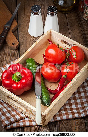 Vegetables in a wooden box. - csp36923223