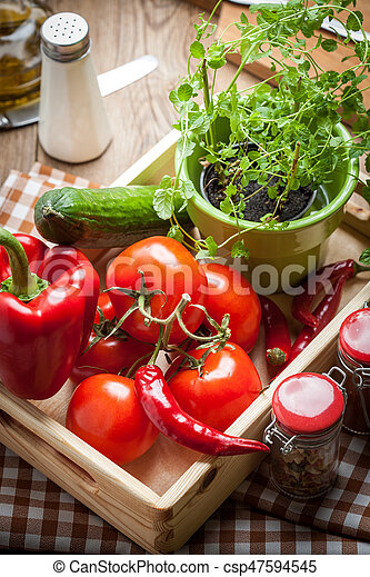 Vegetables in a wooden box. - csp47594545