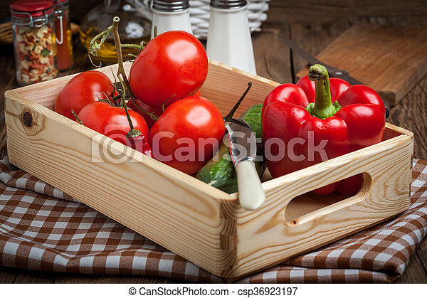 Vegetables in a wooden box. - csp36923197