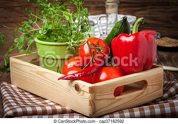 Vegetables in a wooden box. - csp37162592