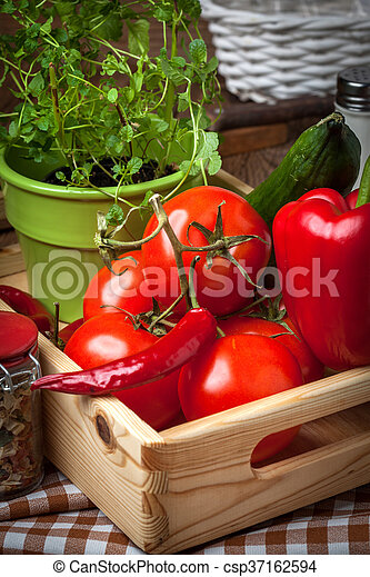 Vegetables in a wooden box. - csp37162594