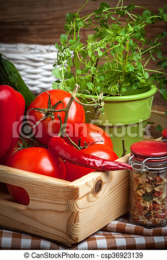 Vegetables in a wooden box. - csp36923139