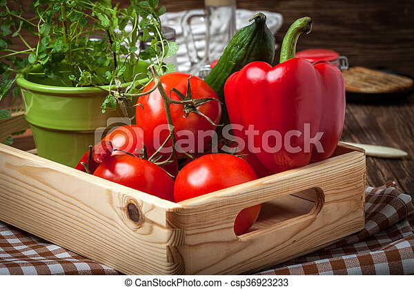 Vegetables in a wooden box. - csp36923233