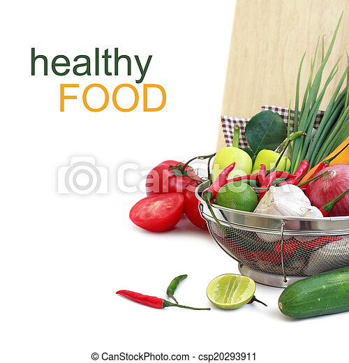 vegetables in metal colander over white (with sample text) - csp20293911