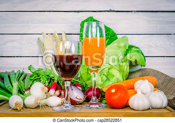 Vegetables on a wooden table with juice - csp28522851