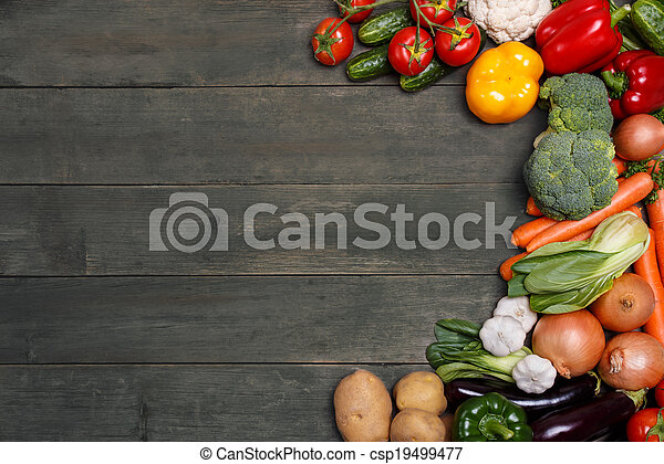 Vegetables on wood background with space for text. Organic food. - csp19499477