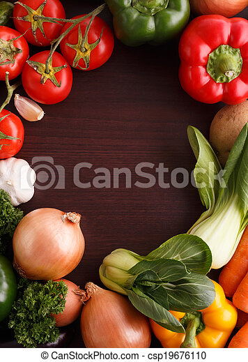 Vegetables on wood background with space for recipe. - csp19676110