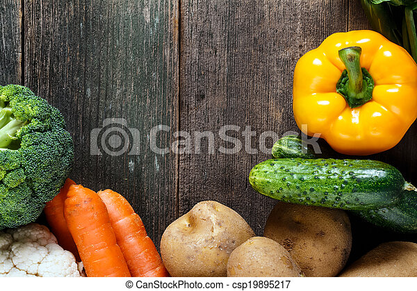 Vegetables on wood background with space for text. Organic food. - csp19895217