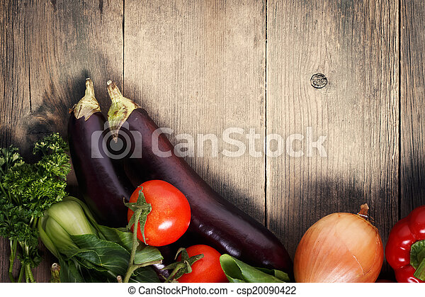 Vegetables on wood background with space for text. Organic food. - csp20090422
