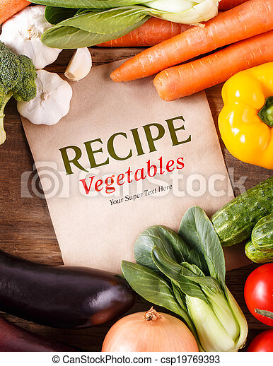 Vegetables on wood background with space for recipe. Organic foo - csp19769393