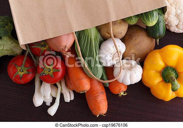 Vegetables on wood background with space for recipe. - csp19676106