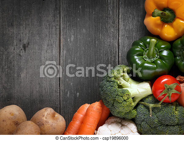 Vegetables on wood background with space for text. Organic food. - csp19896000