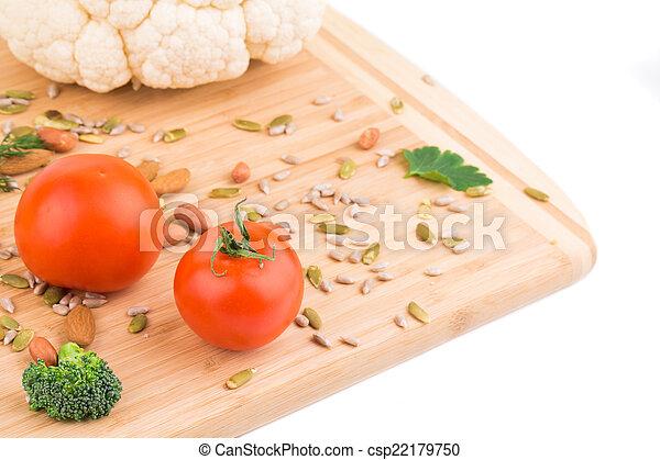 Vegetables on wooden platter. - csp22179750