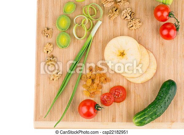 Vegetables on wooden platter. - csp22182951