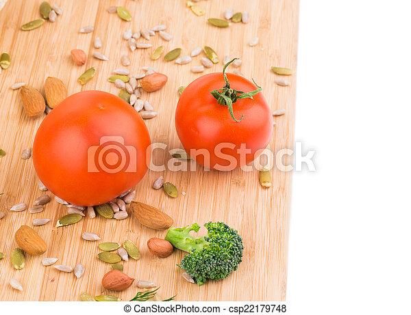 Vegetables on wooden platter. - csp22179748