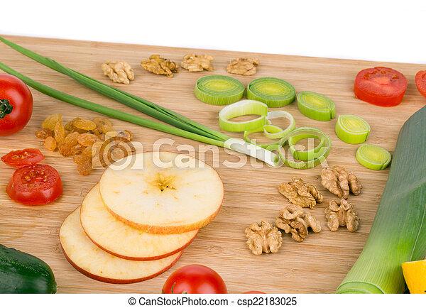 Vegetables on wooden platter. - csp22183025