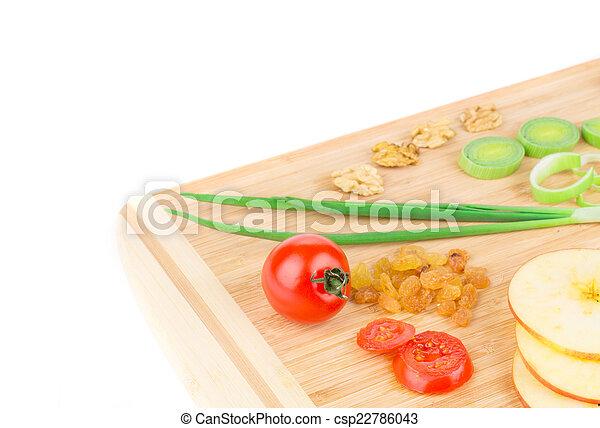 Vegetables on wooden platter. - csp22786043