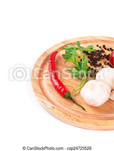 Vegetables on wooden platter. - csp24723529