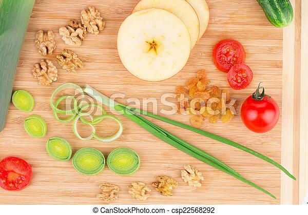 Vegetables on wooden platter. - csp22568292