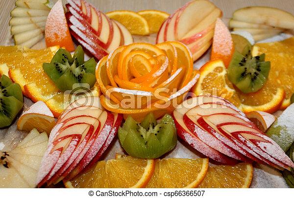 Vegetarian fruit salad of kiwi, orange, citrus and Apple. Vitamin Breakfast and fresh fruit salad for a healthy lifestyle. - csp66366507