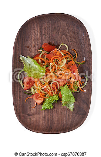 Vegetarian vegetable salad on a wooden plate isolated - csp67870387