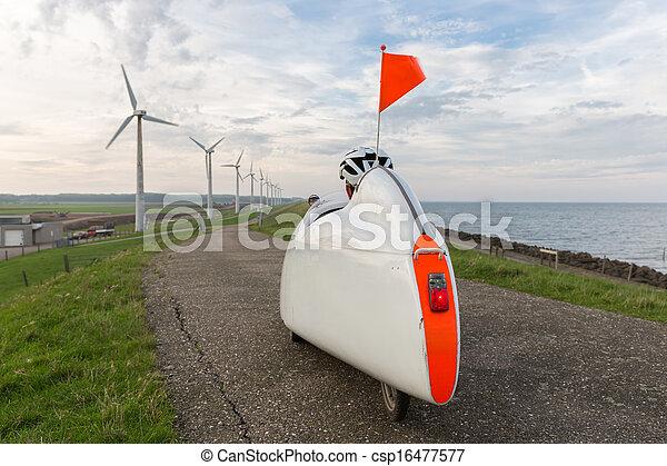 Velomobile bicycle along Dutch coast - csp16477577
