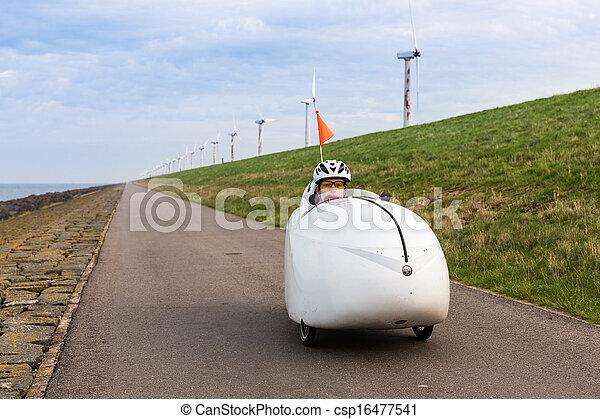 Velomobile bicycle along Dutch coast - csp16477541