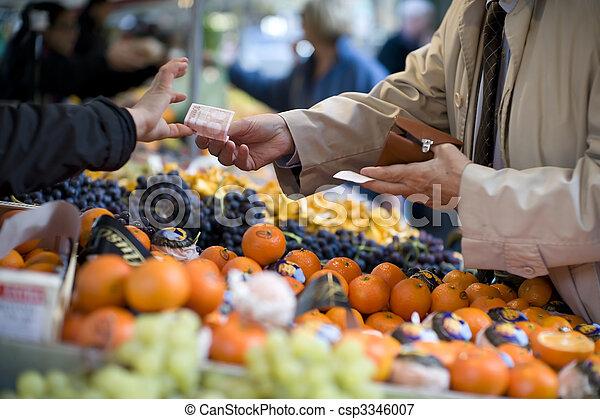 Vendor accepts payment at a street market - csp3346007
