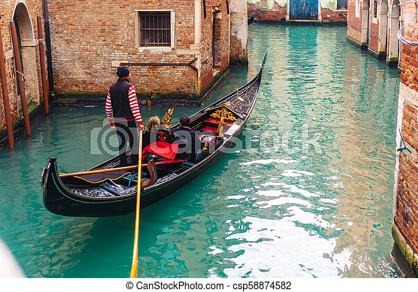 Venetian channel with ancient houses and boats - csp58874582