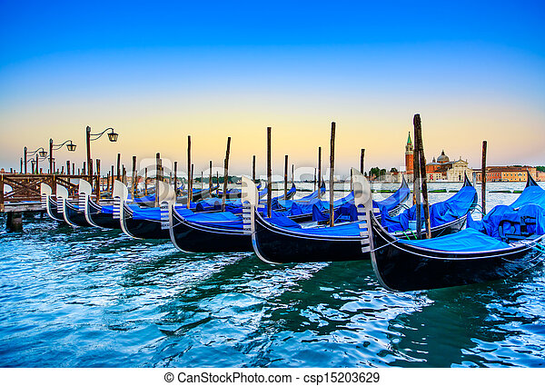 Venice, gondolas or gondole on sunset and church on background. Italy - csp15203629