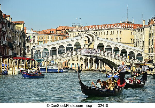 VENICE - March 28: Gondola at Rialto Bridge on March 28, 2012 in Venice, Italy. There were several thousand gondolas in the 18th century, with only several hundred today for tourism. - csp11132410