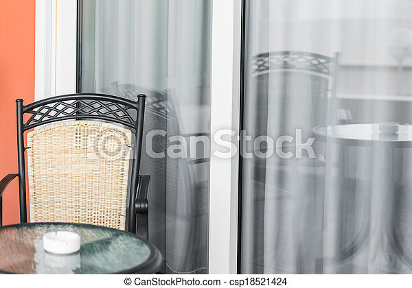 veranda with a glass door - csp18521424 & Veranda with a glass door. Table and chair front porch is... stock ...