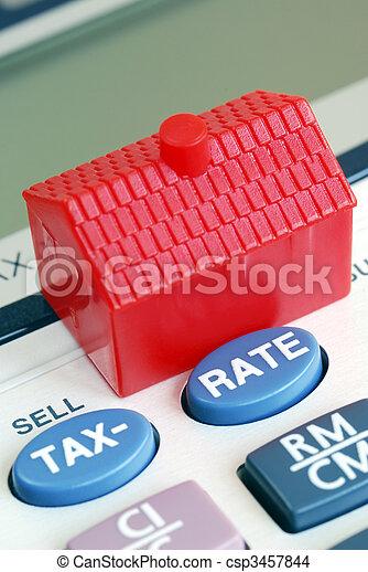 Calcula la tasa de hipotecas y impuestos en bienes raíces - csp3457844