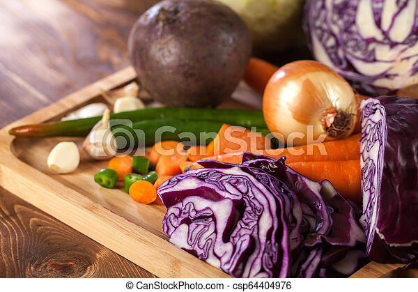 Verious fresh vegetables on a wooden table, healthy food - csp64404976