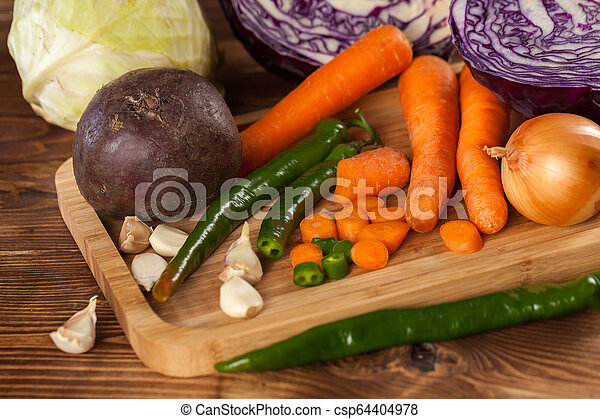 Verious fresh vegetables on a wooden table, healthy food - csp64404978