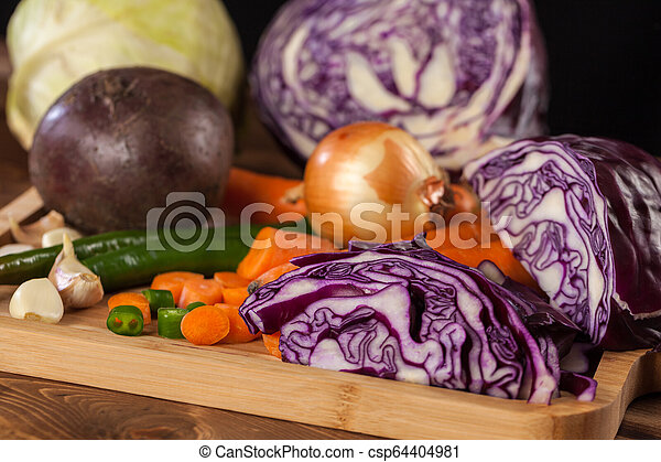 Verious fresh vegetables on a wooden table, healthy food - csp64404981