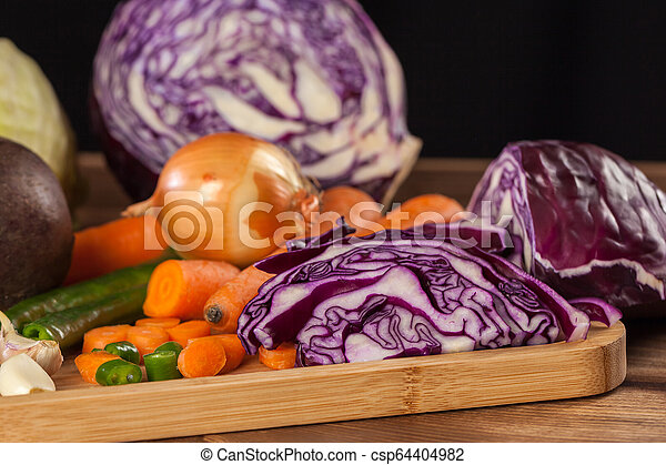 Verious fresh vegetables on a wooden table, healthy food - csp64404982