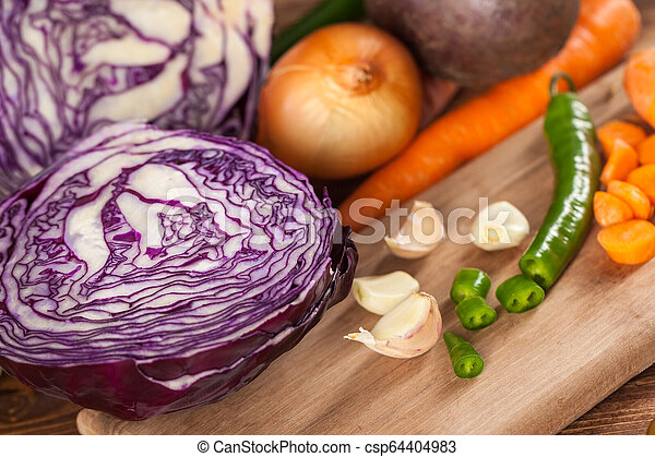 Verious fresh vegetables on a wooden table, healthy food - csp64404983