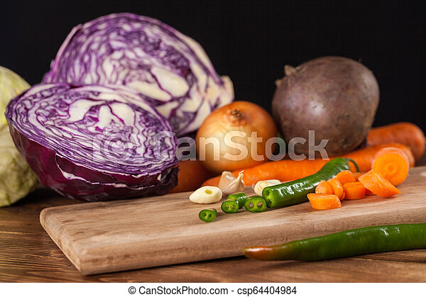 Verious fresh vegetables on a wooden table, healthy food - csp64404984