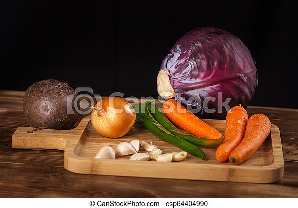 Verious fresh vegetables on a wooden table, healthy food - csp64404990