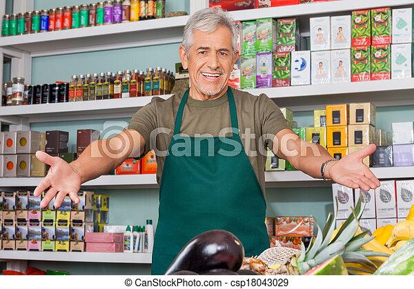 verkoper, outstretched wapens, supermarkt - csp18043029