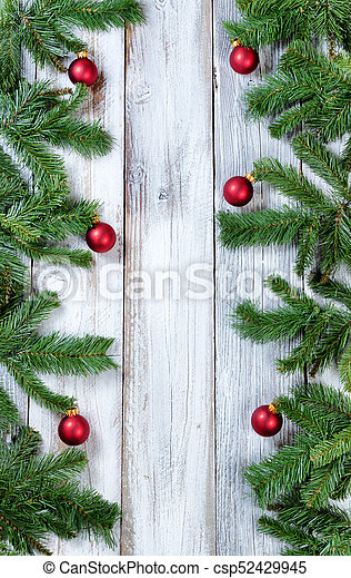 Vertical Borders Of Christmas Red Ornaments Hanging In Evergreen Tree Branches