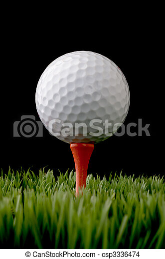 vertical close up of a white golf ball on a tee on black - csp3336474