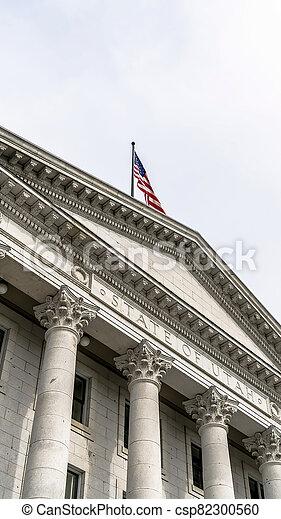 Vertical crop Pedimented entrance of historic Utah State Capital building in Salt Lake City - csp82300560