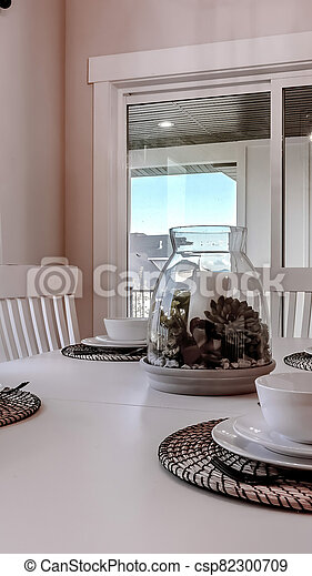 Vertical Dining Table With Chairs And Tableware Arranged Around A Decorative Centerpiece The Sliding Windows In Teh Room Canstock